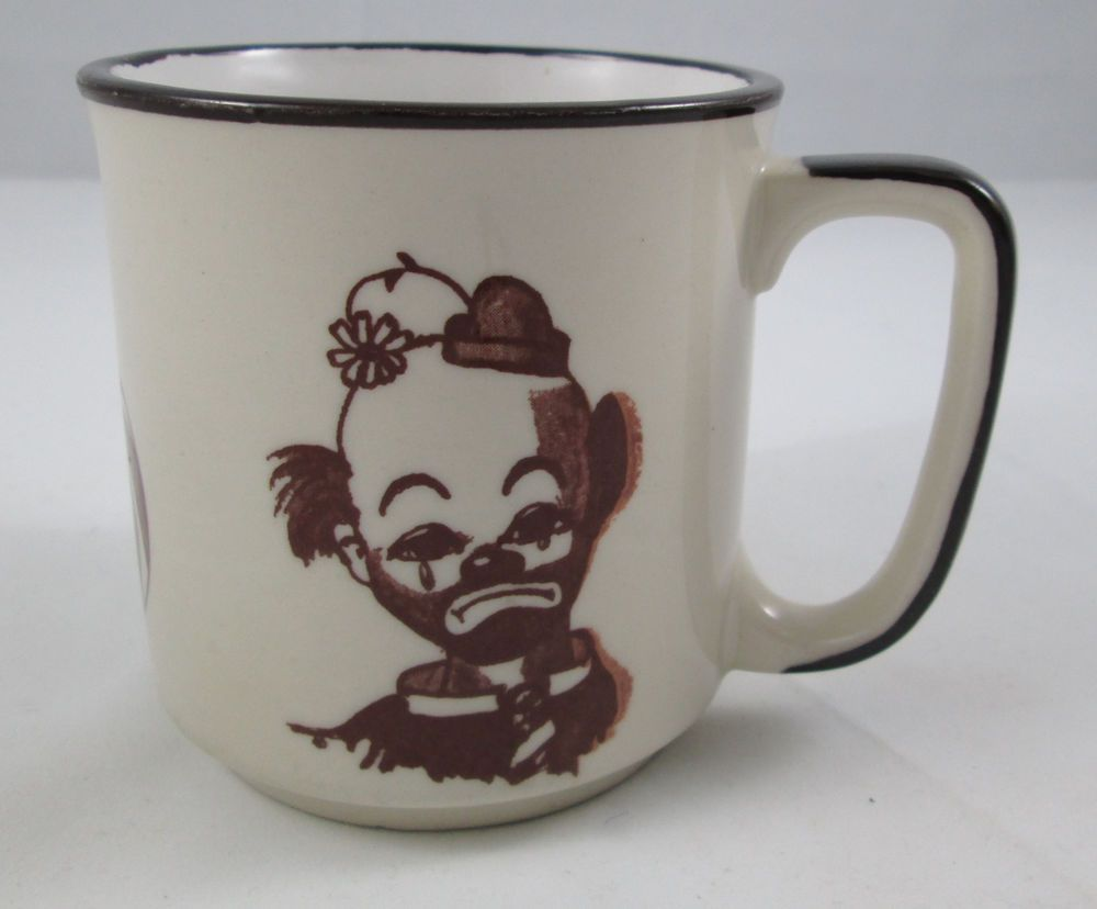 Don't be afraid, it's just a sad clown.  Funky vintage sad clowns and circus ball stoneware mug made in Japan