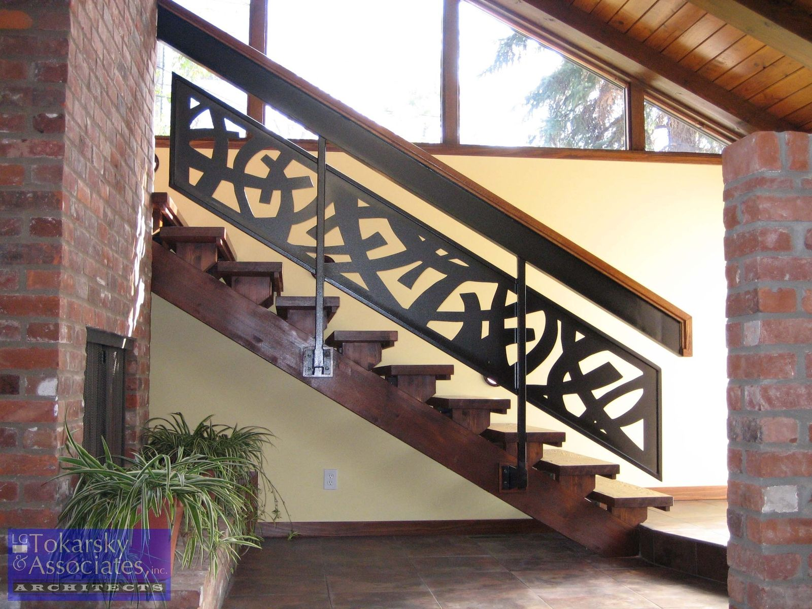 custom modern stainless steel cable railing open staircase designed fabricated and installed for a residential property in chicago