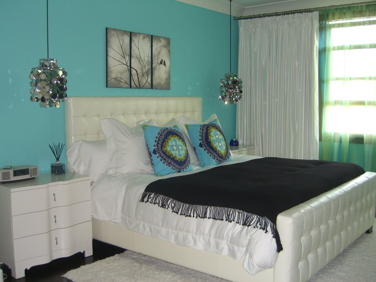divine artwork canvas portray over turquoise bedroom dresser