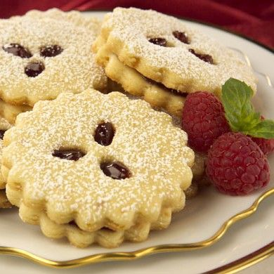 Linzer Cookies: Raspberry preserves sandwiched between buttery cut-out cookies