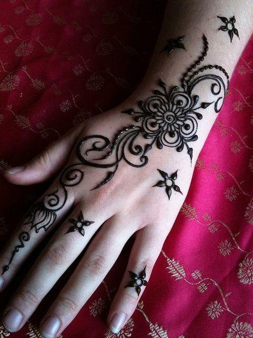 Flower Finger Tattoos Henna Flowers Tattoo On Left Back Hand