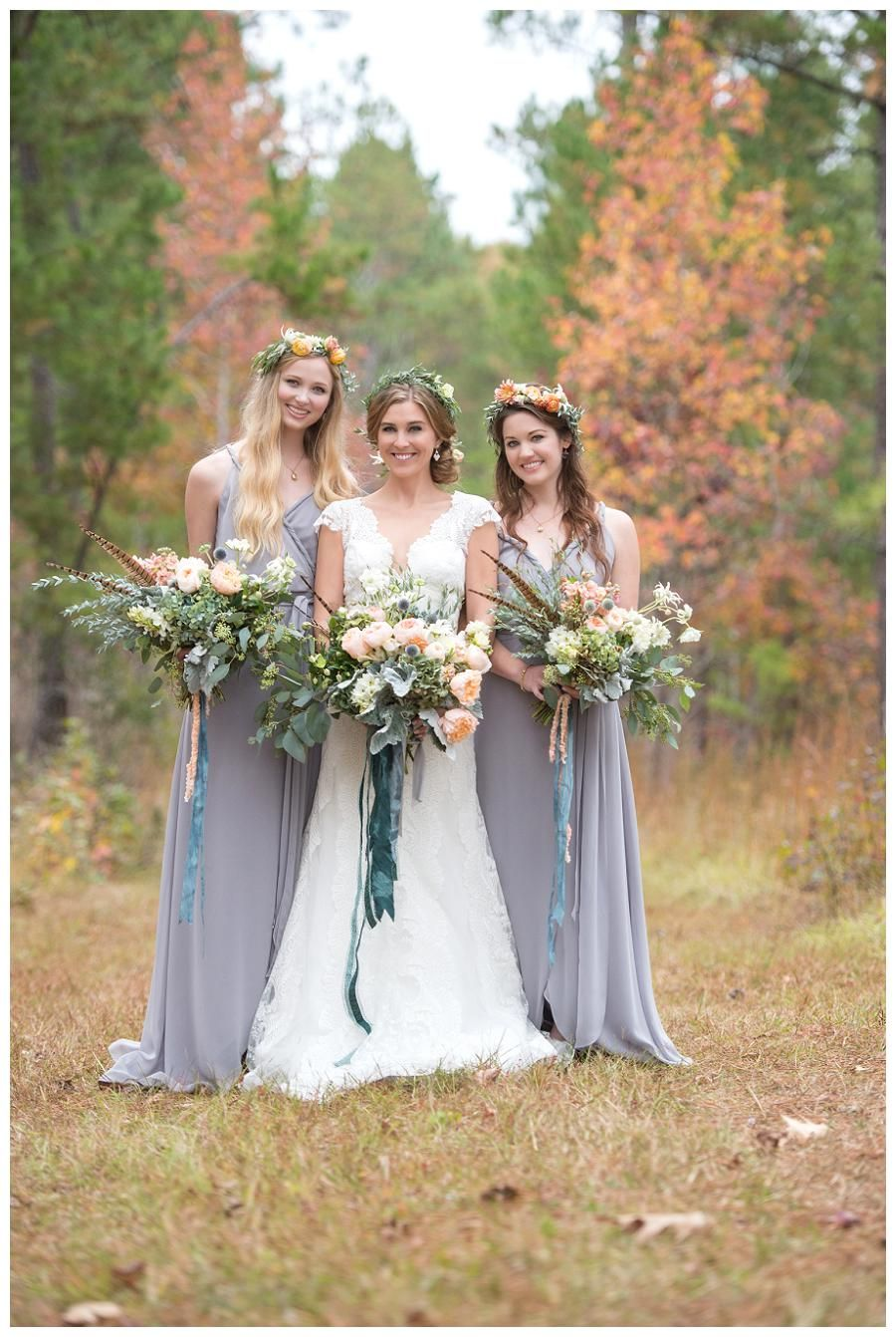 Bride and bridesmaids with bouquets of pastel flowers and pheasant bride and bridesmaids with bouquets of pastel flowers and pheasant feathers wedding dress by lela ombrellifo Image collections
