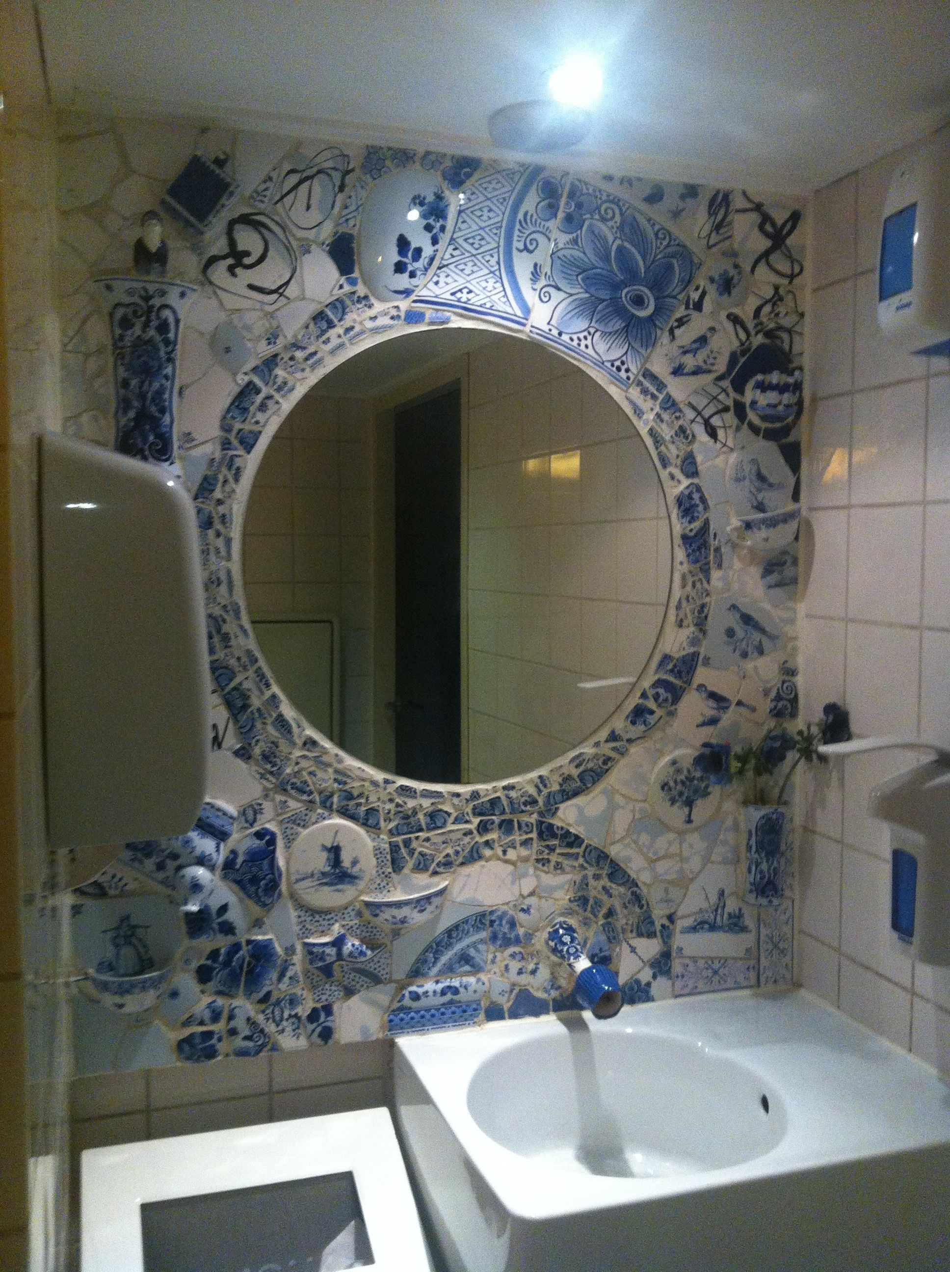 Broken Delft Blue china creates a mirror frame