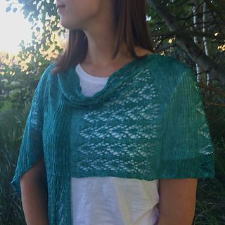 The Sedona Lace Scarf is a generously sized rectangular scarf which can also be worn as a shawl or wrap. With alternating panels of an easy-to-memorize lace stitch and garter stitch, knitting up this elegant scarf will keep you interested without being tedious.