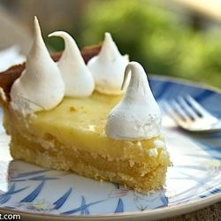 This tart is a combination of moist almond cake and lemon meringue pie and tastes fantastic!