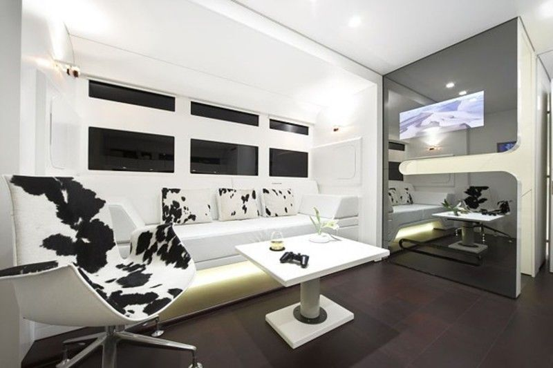 white walls, angular couch, small coffee table, glass room divider ...