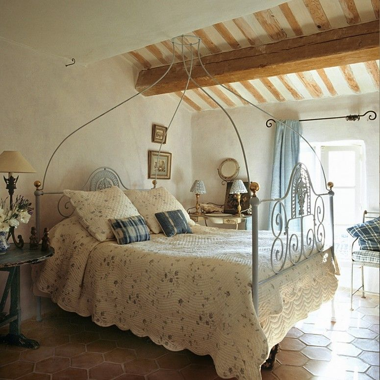 french bedroom w/ metal canopy bed