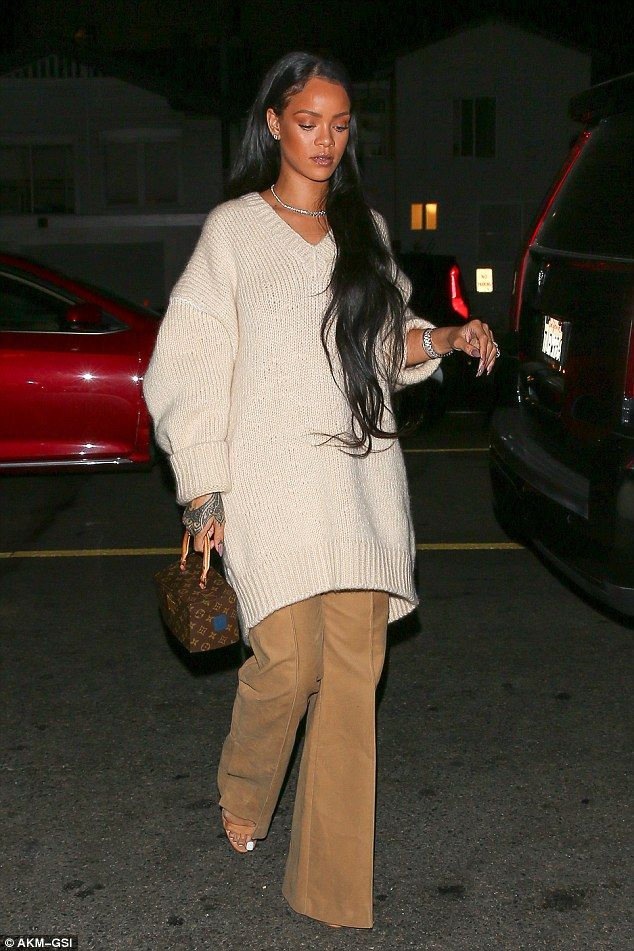 Rihanna steps out without Drake in a chic and unde