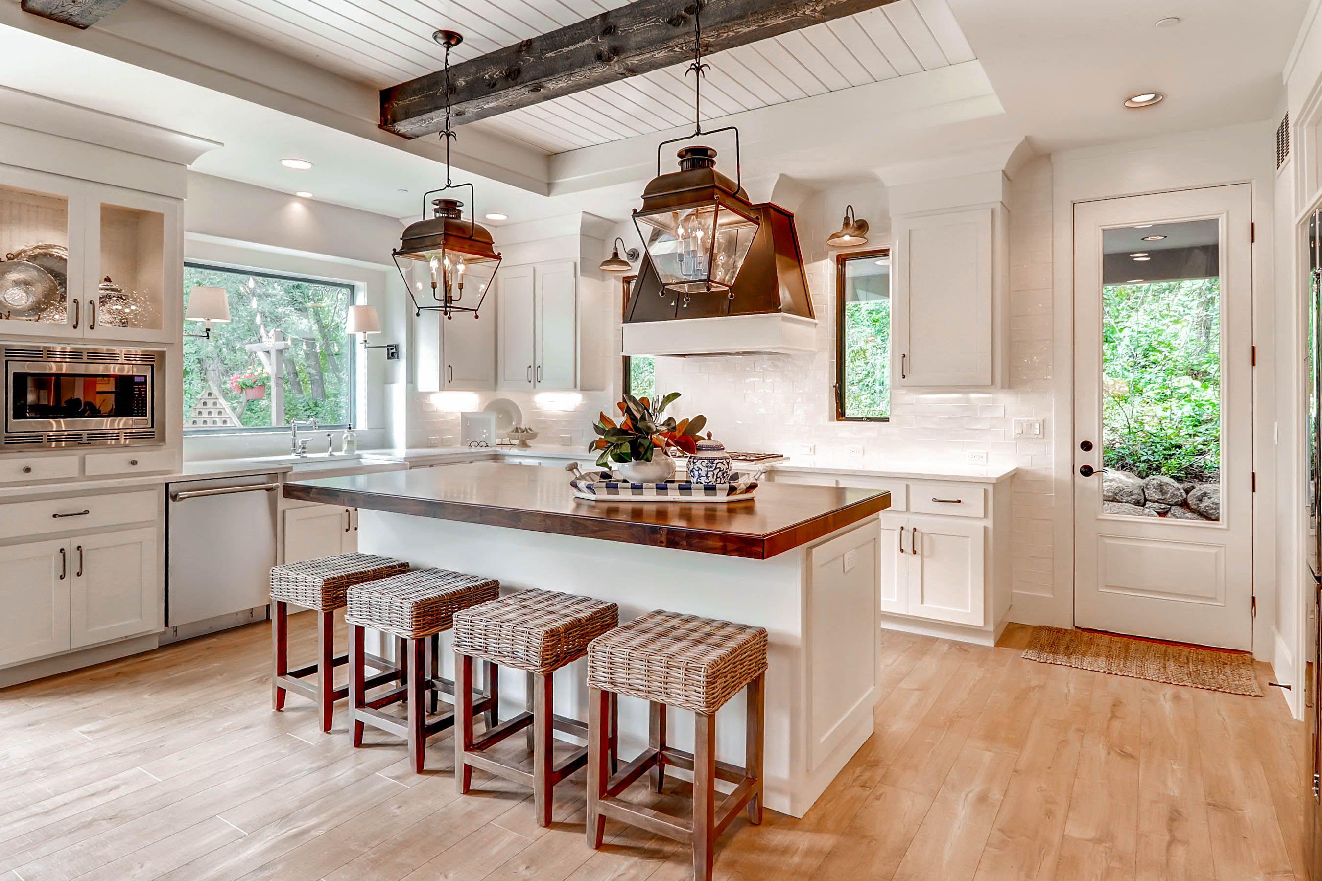 Beautiful white farmhouse kitchen! Flooring is Quick Step