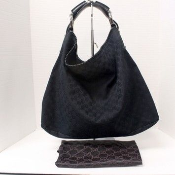 3bb15697438 Hobo bags are hot this season! The Gucci Signature Monogram Canvas Horse  Bit Handle Hobo Bag is a top 10 member favorite on Tradesy.