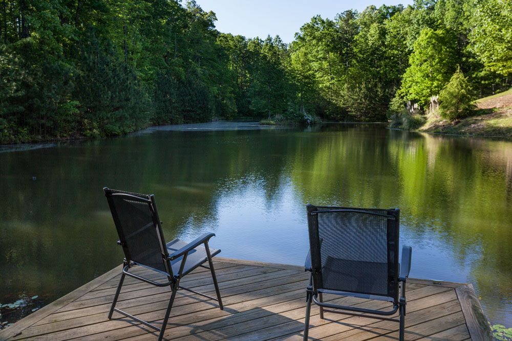 Lakeside Majesty's private stocked lake Cabin rentals