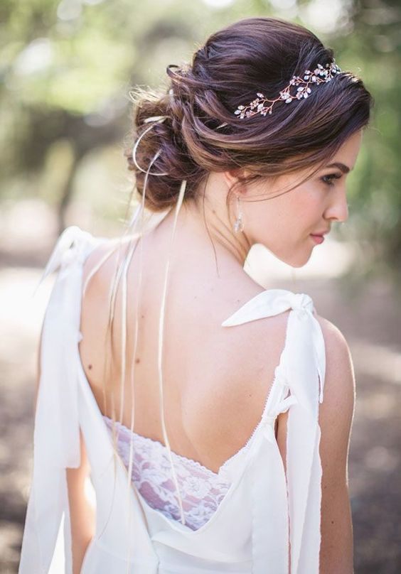 Enchanting low updo wedding hairstyle with simple crown headpiece; Featured Photographer: Jasmine Star