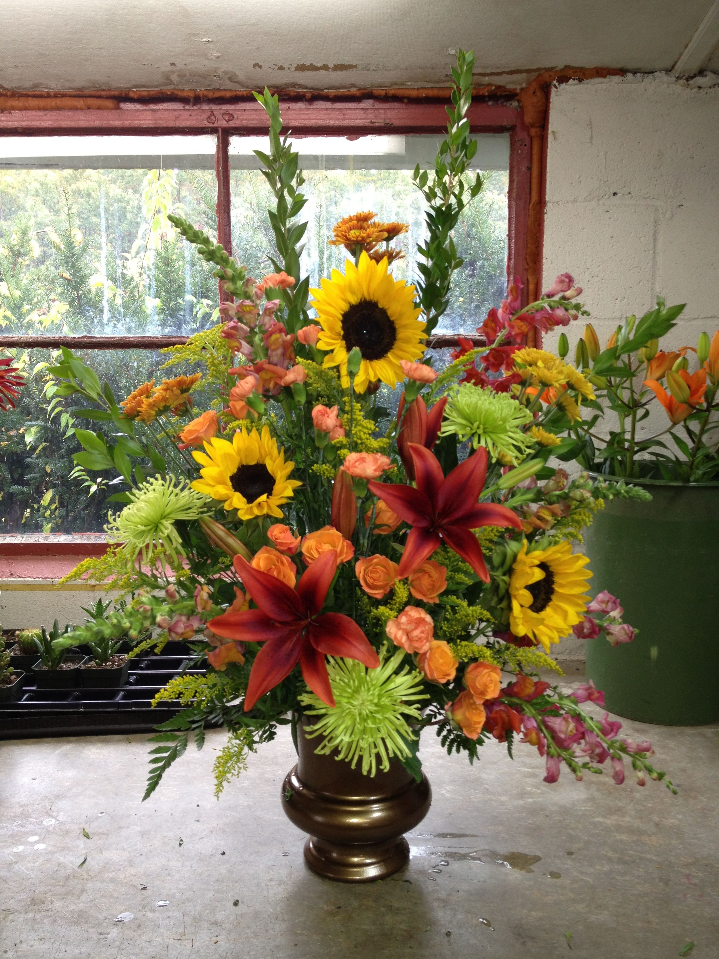 Floral arrangement in all fall colors. Just love for the
