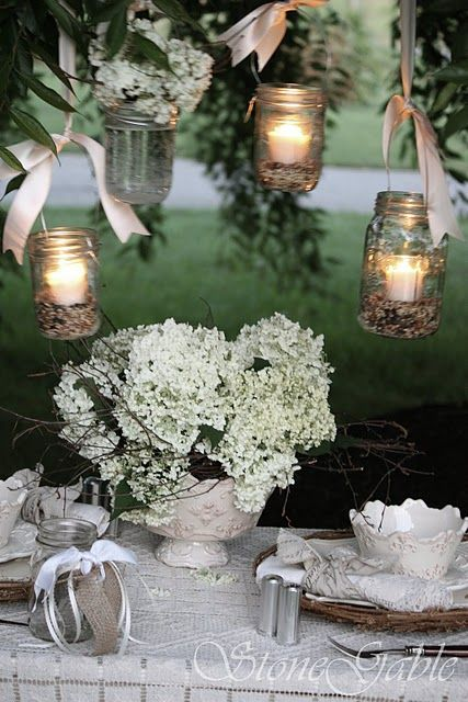 hanging candle jars...candles set in birdseed <3