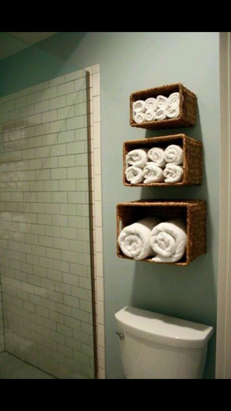Attractive Bathroom Towel Storage Ideas: Another Way To Take Advantage Of Vertical  Space Is By Hanging Baskets On The Wall Above The Toilet Or Tub ...