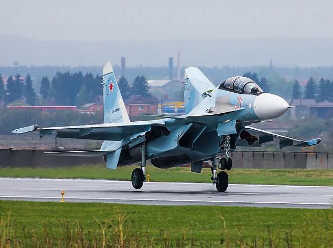 A Russian Air Force Sukhoi Su-30SM touches down on the runway.