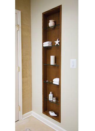 A decorative teak shelf adorns the back wall of this #bathroom ...