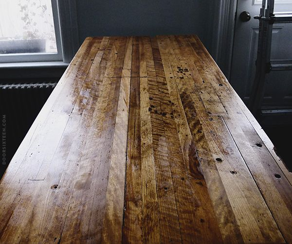 Refinished table. Revamp an old workbench into a kitchen island   via doorsixteen