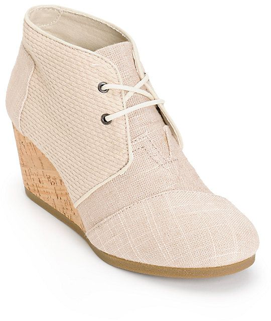 7a5f168a534 A burlap upper with textured panel detailing is constructed atop a cork  wedge for a clean look that can be dressed up