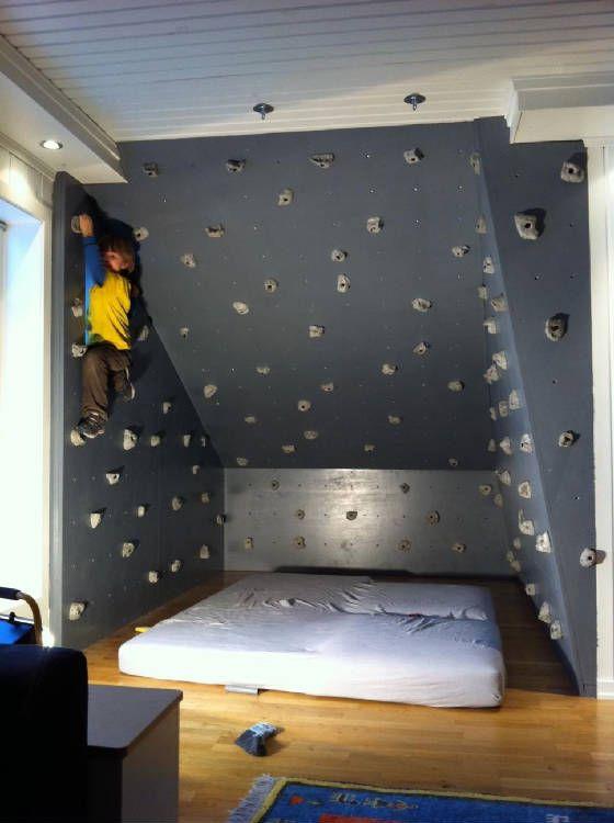 Kids boulder wall right by matress on floor dojo gym ideas