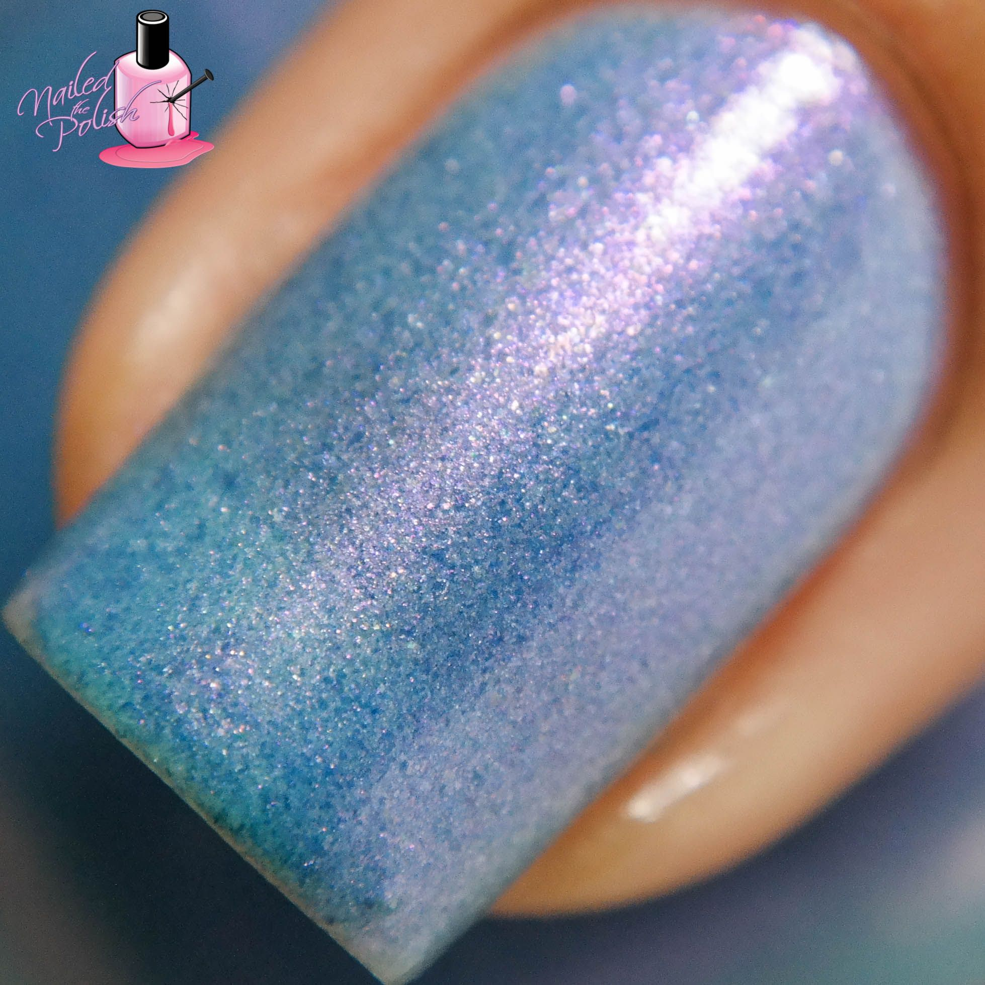 Buh Buh Buh Buh Buh - Periwinkle blue jelly base with intense violet shimmer and micro flake.  This polish glows and the color differs in different lighting and hand movement. Swatch by @nailedthepolish on Instagram.