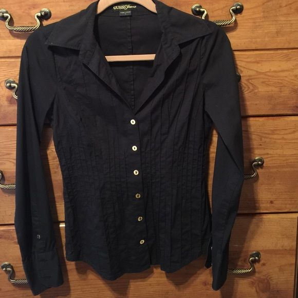 Guess dressy black button down w/ gold buttons Black dressy button down shirt with gold buttons, front side small pleats, plain back. 3 gold buttons on sleeves, 69% cotton, 26% nylon and 5% spandex, very stretchy with a flattering fit. Guess Tops Button Down Shirts