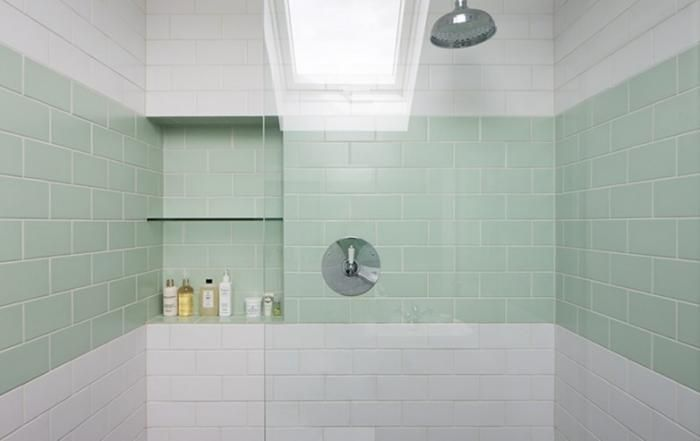 A Stripe Of Mint Green Tile In The Shower Of A Victorian House In East  London