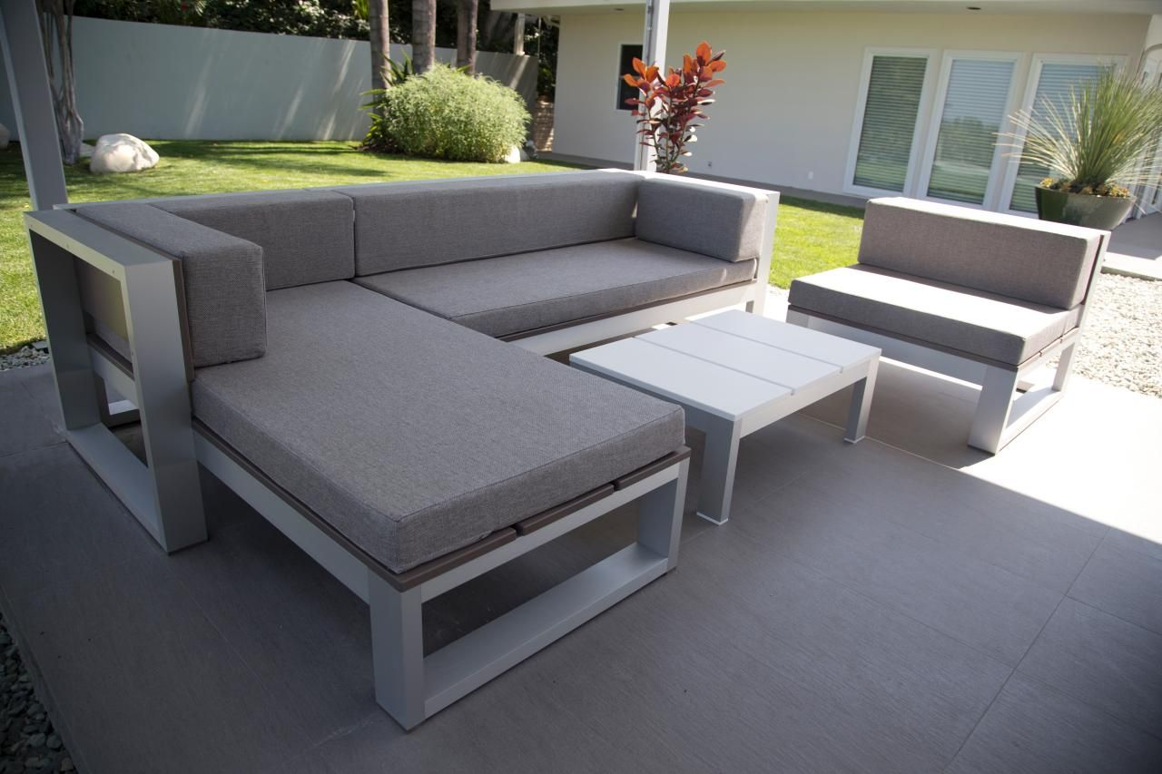 Diy sofa plans build your own couch build your own couch with - This Chic Gray Outdoor Sectional And Matching Chair Offer A Comfy Place For Kicking Up Your Feet With A Book In The Middle Of The Afternoon