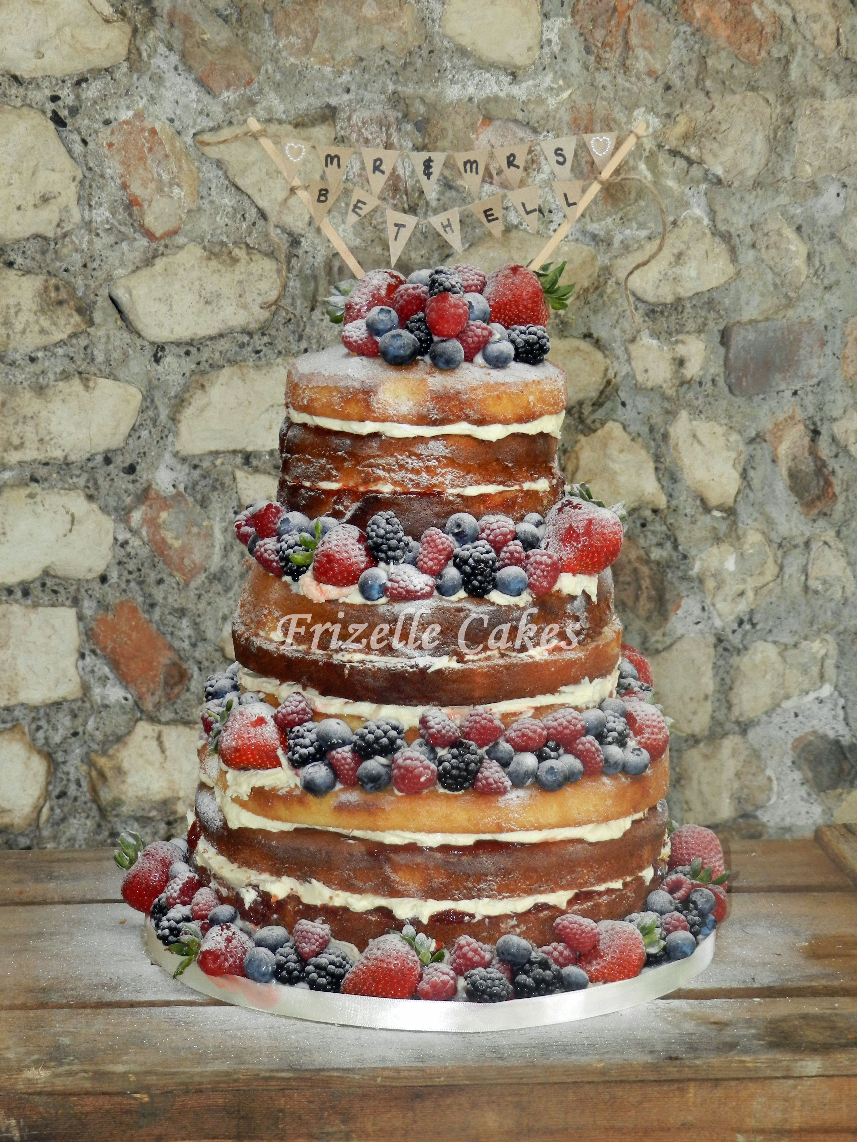 bare sponge wedding cakes a quot bare quot or quot quot wedding cake piles high with fresh 11074