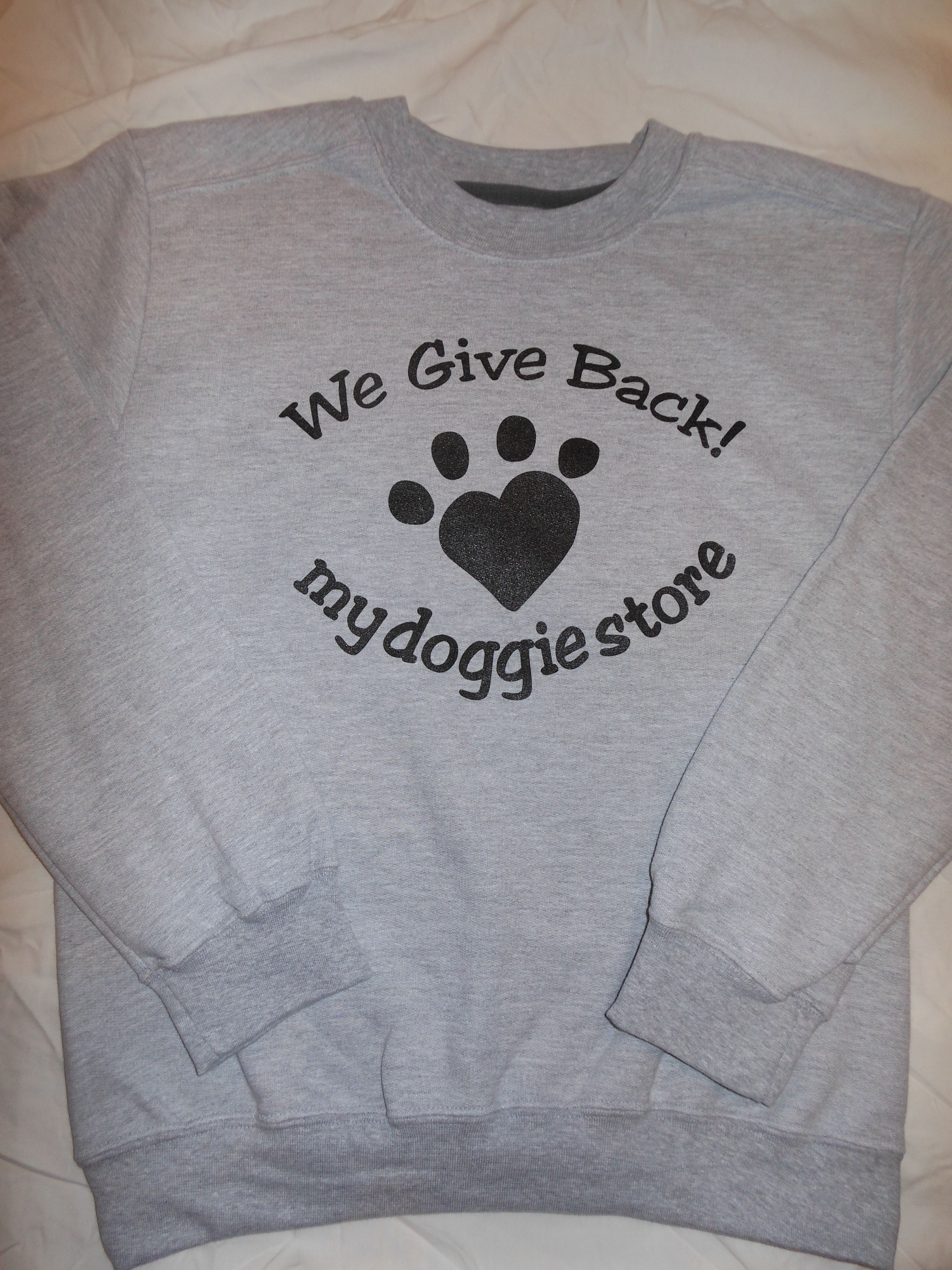 Show your love for dogs with our mydoggiestore crewneck sweatshirts sporting our cute heart-shaped paw logo! 10% of our nets sales are donated back!