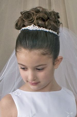 First Communion Hairstyle with Tiara and Veil ...love the ...
