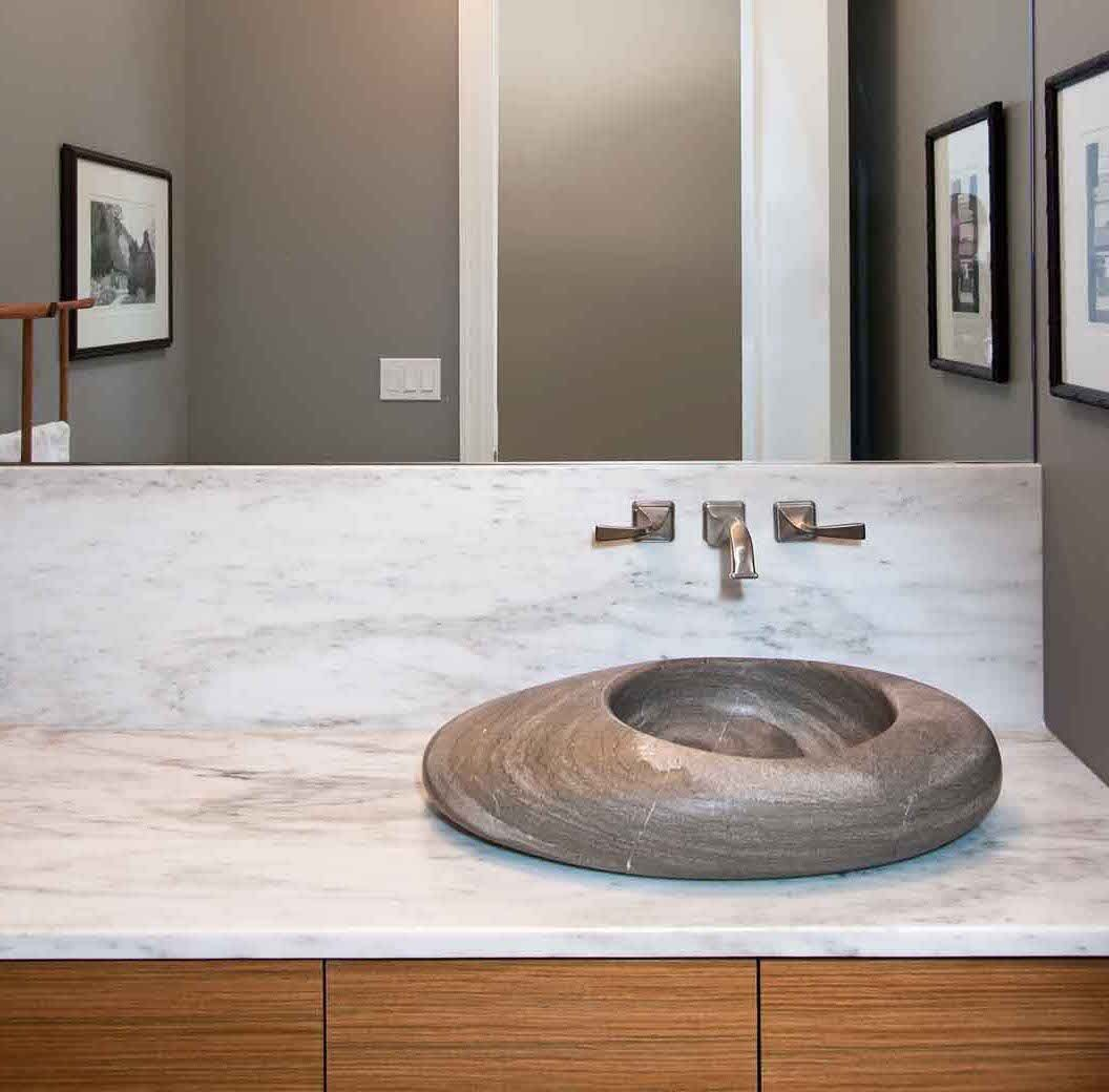 Gallery One modern powder room sink sculptural stone bowl sink on a marble vanity top amy
