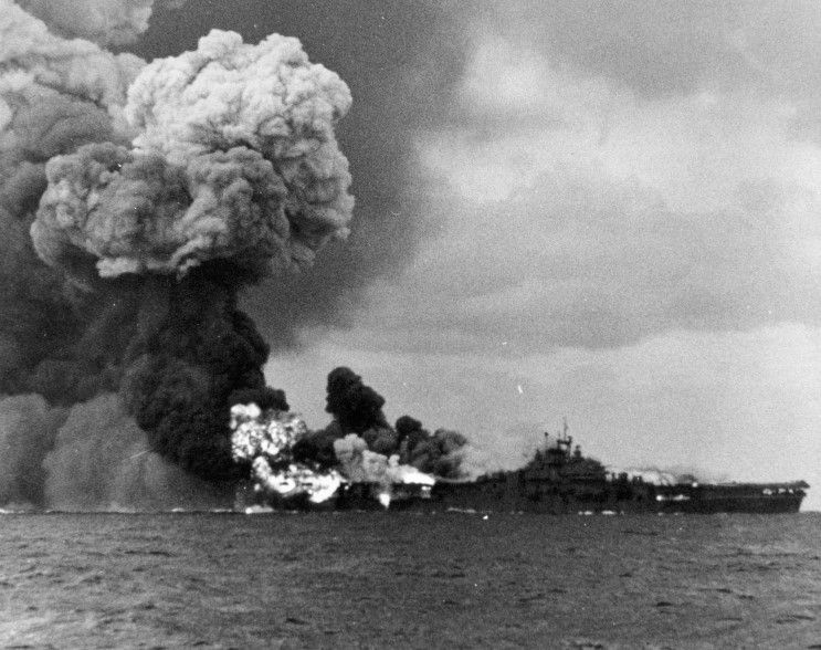 March 19, 1945: USS Franklin CV-13 on fire after being ...