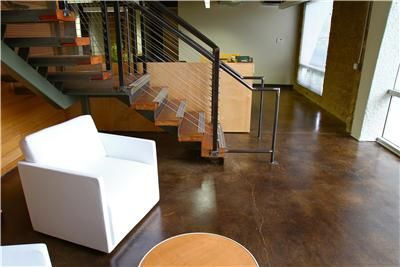 The concrete stain used for this interior floor has imparted a rich brown hue that offers a nice contrast to the white furniture.  Westcoat San Diego, CA