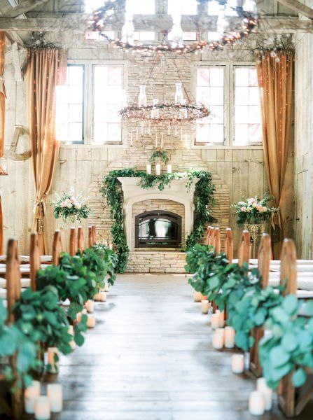 Greenery wedding ceremony decor idea stone fireplace decorated with at indoor venue candles and line the long aisle also ways to decorate  mantel your ever after rh pinterest