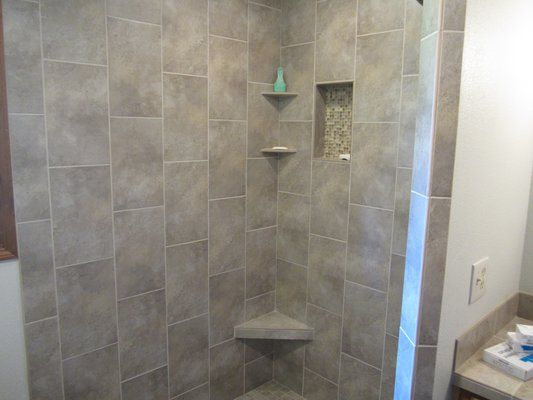 Large Format Tiles In Vertical Design Yelp Tiny Bathrooms Small Bathroom Design Brick Laying
