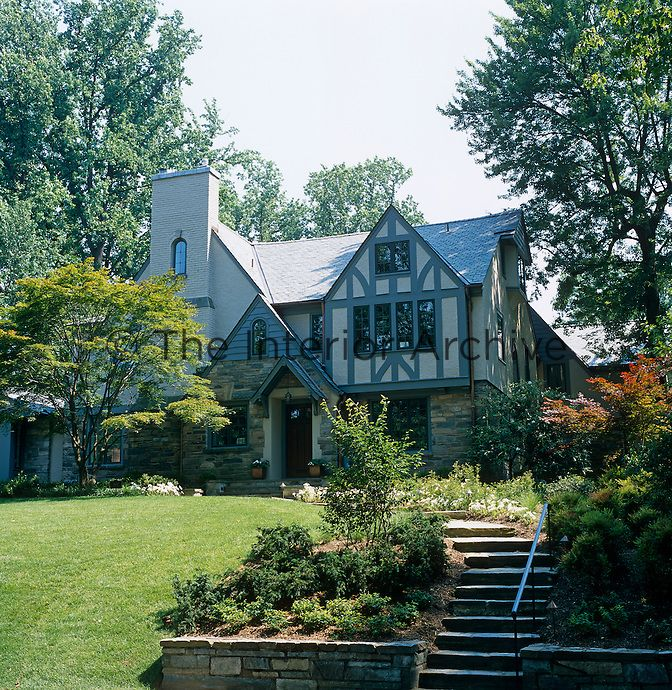 the tudor style house built in 1928 has been enhanced with a