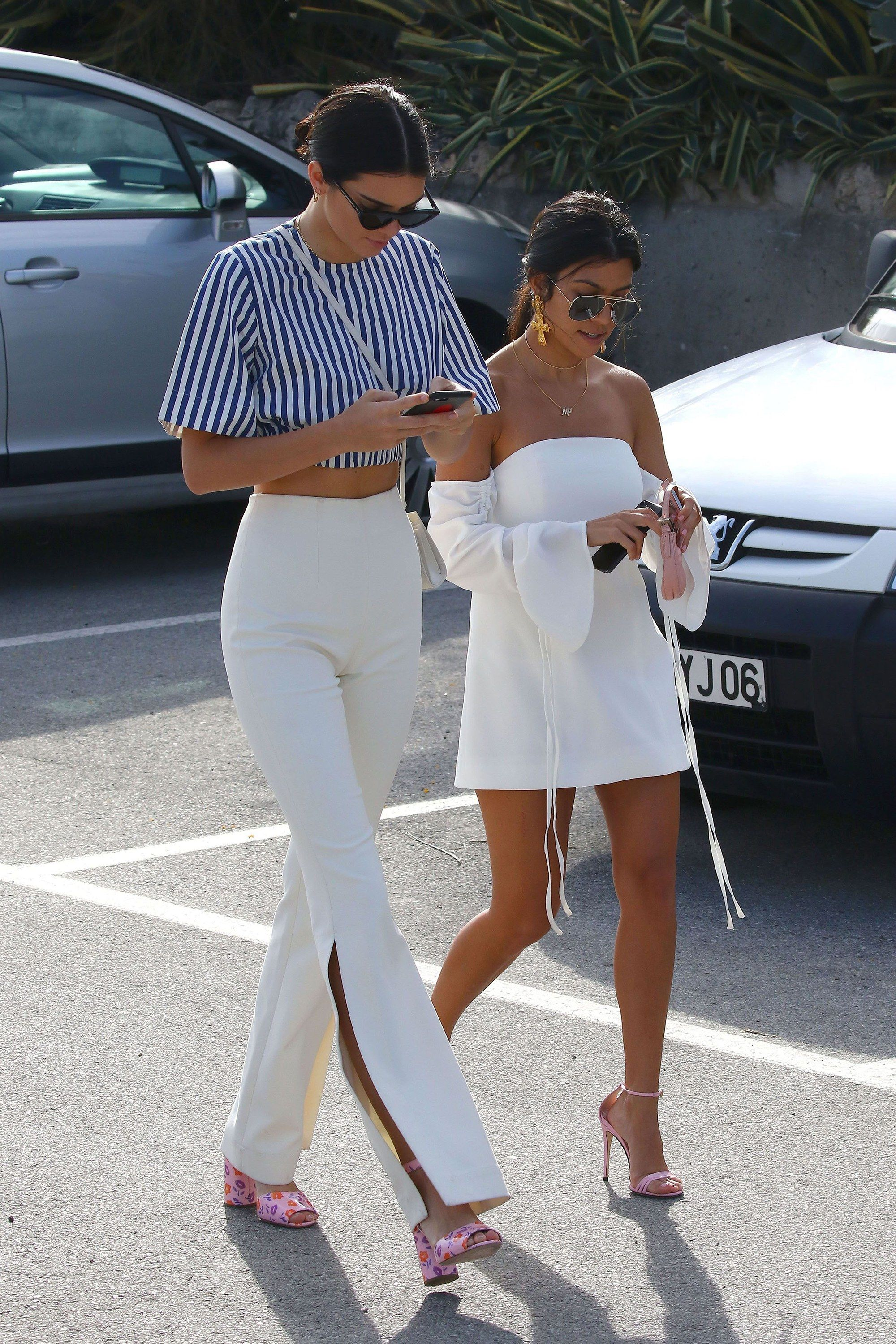 6d2ffe02752 Kendall Jenner wearing Solace London - navy   white stripe top   high  waisted cream pants