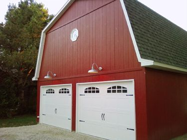 A garage with the styling of a barn? What better of a place for a ...