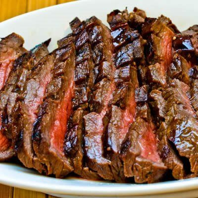 Flank steak that's marinated overnight and then cooked to medium-rare is one of my favorite things to cook on the grill.