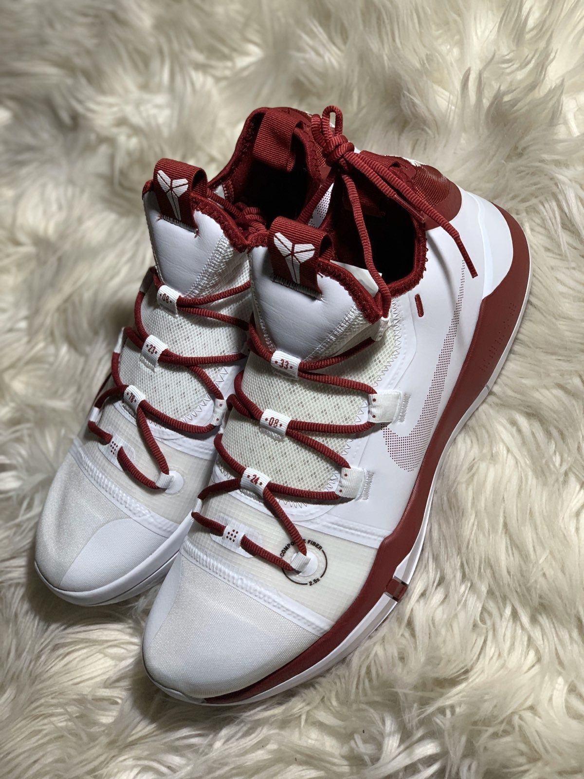 """Thank you for considering our store! We appreciate your business and support! For Sale: Nike Kobe Bryant AD TB Basketball Shoes White / Red AT3874-109 Men's 12.5 Men's Size 14.5 Also available! Please check out our other listings for other available sizes Condition: New without box Shipped to you fast via USPS Priority Mail We consider all resonable offers! With that said, we invite you to """"watch"""" our items to receive special offers sent directly to you! Thank you for visiting!"""