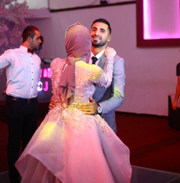 Bride and groom islamic couple engagement dress pink rose