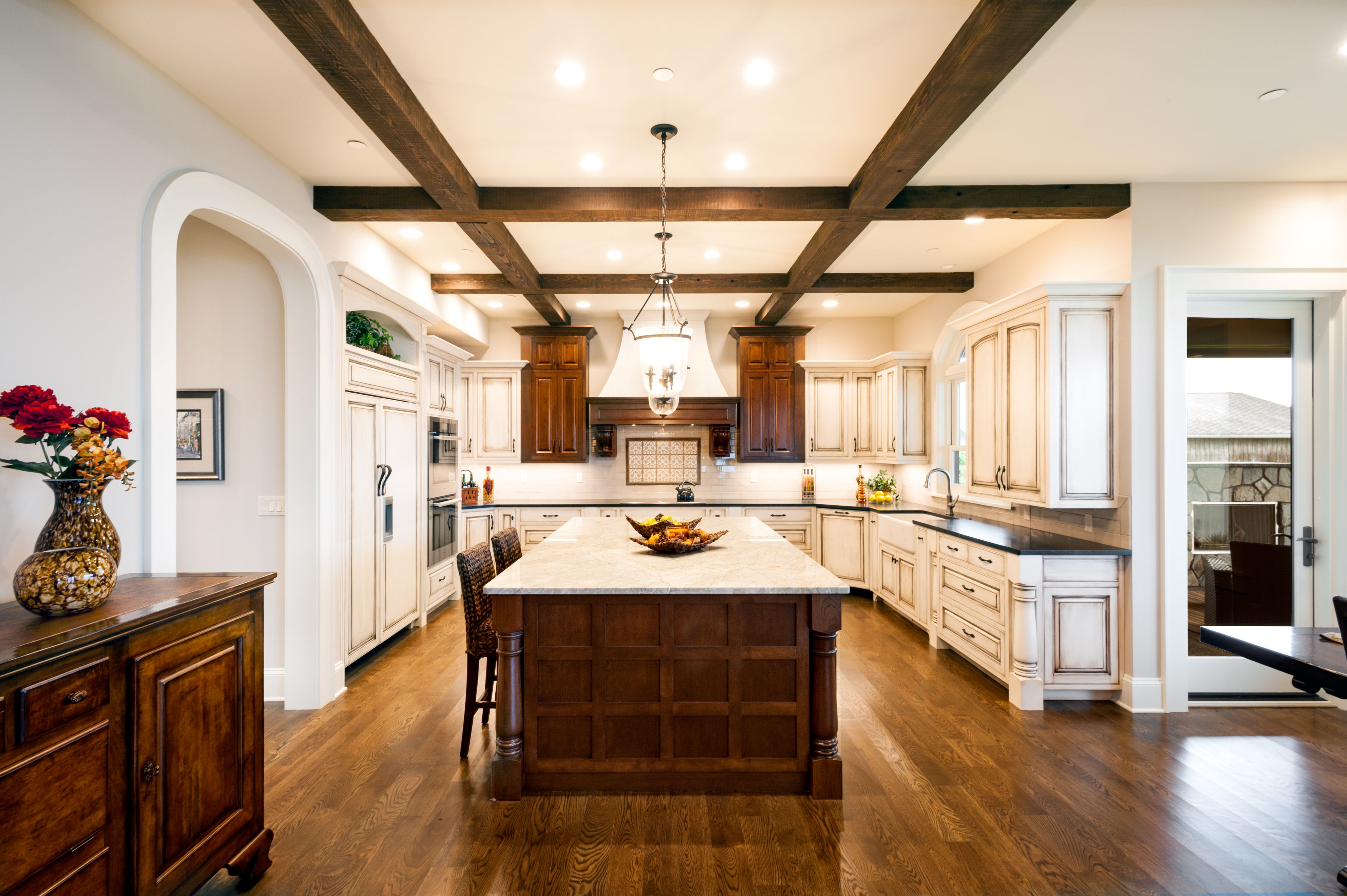 Kitchen With White And Dark Stained Custom Cabinets Exposed Reclaimed Beams White Oak Fl Kitchen Cabinetry Design Paint Cabinets White Painting Oak Cabinets