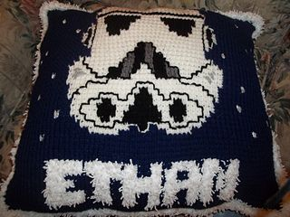 This afghan stitch pattern was originally designed as a Christmas gift for my cousin. Hee is crazy about Star Wars and loves drawing Storm Troopers. The pattern includes written instructions as well as a color chart. I've also included instructions on how to create the pillow as well as how to customize it.