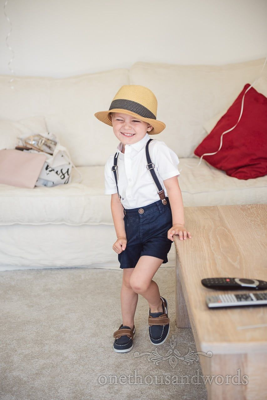 Cute page boy in hat on wedding morning pageboy