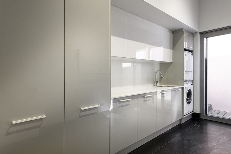 Custom Made Laundry Renovation. High Gloss Doors And A Subtle Dual Tone Set