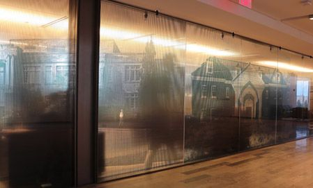 Privacy through clear printable window film at Western University's Ivey School of Business by Window Film Systems