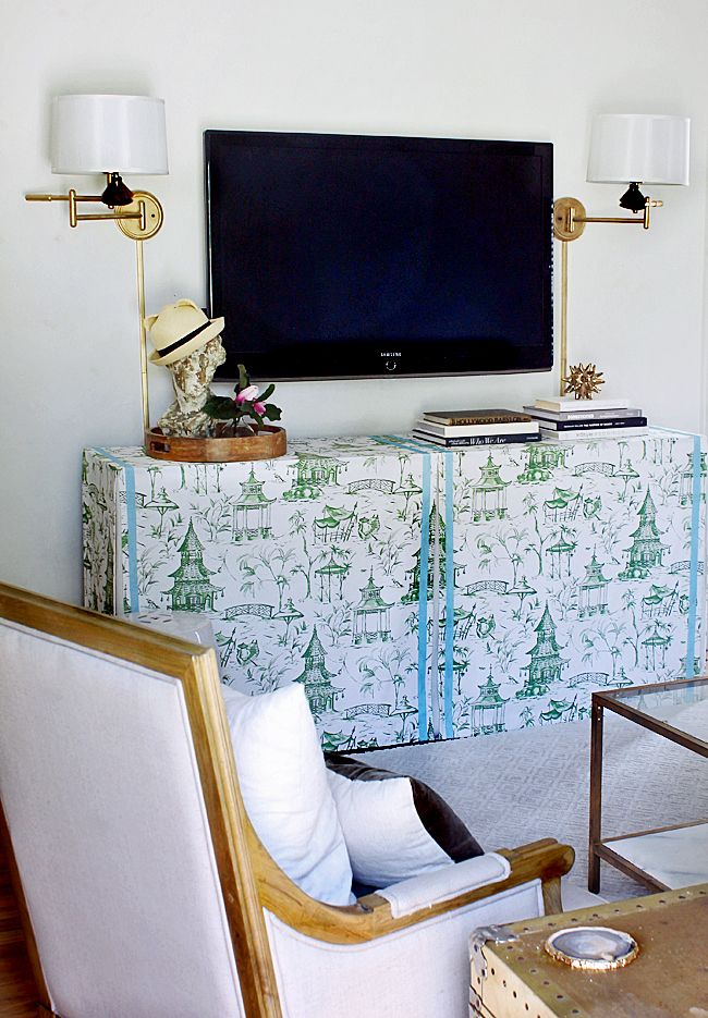 Not the fabric but I like the idea of a skirted console table ...