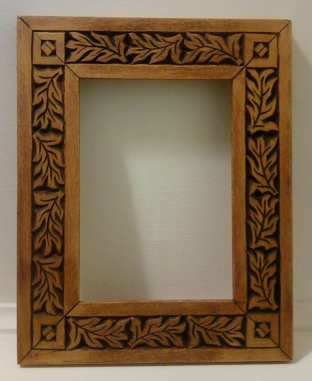 Carved wood frame dancing leaves chip