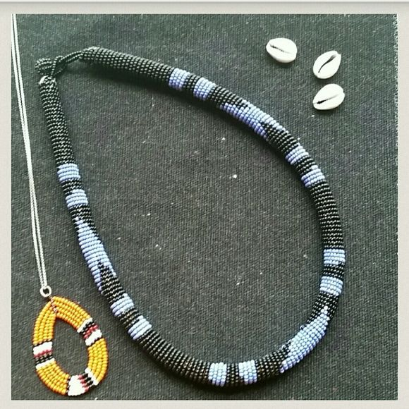 West African Hand Beaded Necklace Channel your inner indigenous person wearing this lovely hand beaded West African Necklace. Great with jeans or a Little Black Dress.    Listing is for the Blue & Black necklace only.   Straight out of the Motherland Jewelry Necklaces